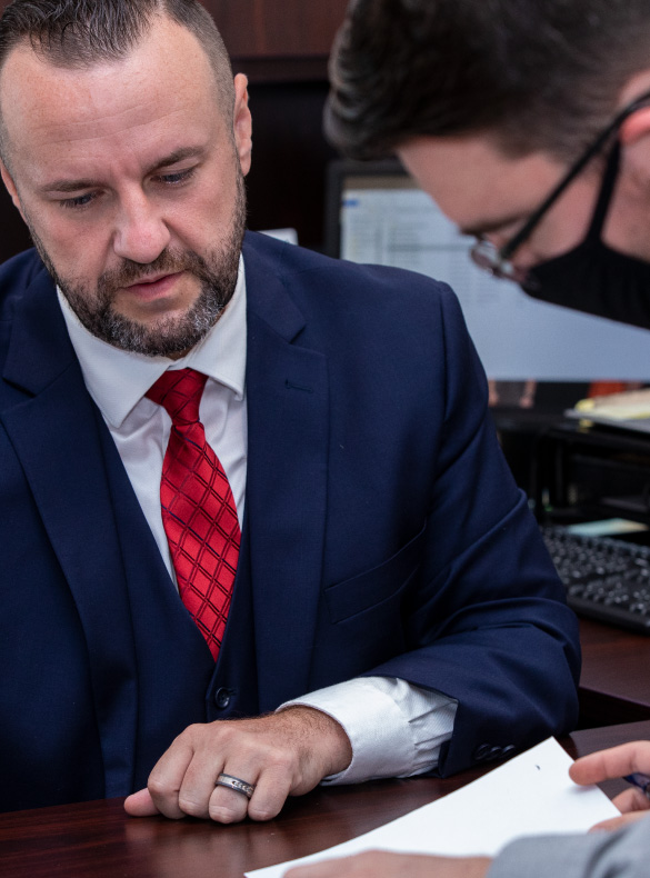 men reviewing paperwork