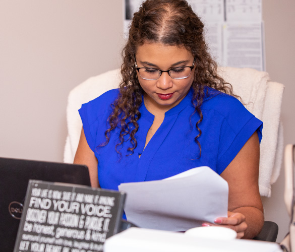 a woman looking at paperwork